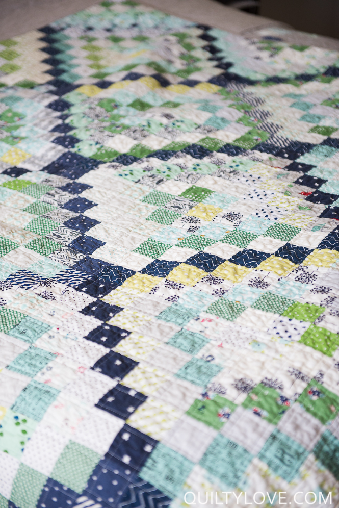 Scrappy trip around the world quilt quilted and made by emily of Quilty Love.