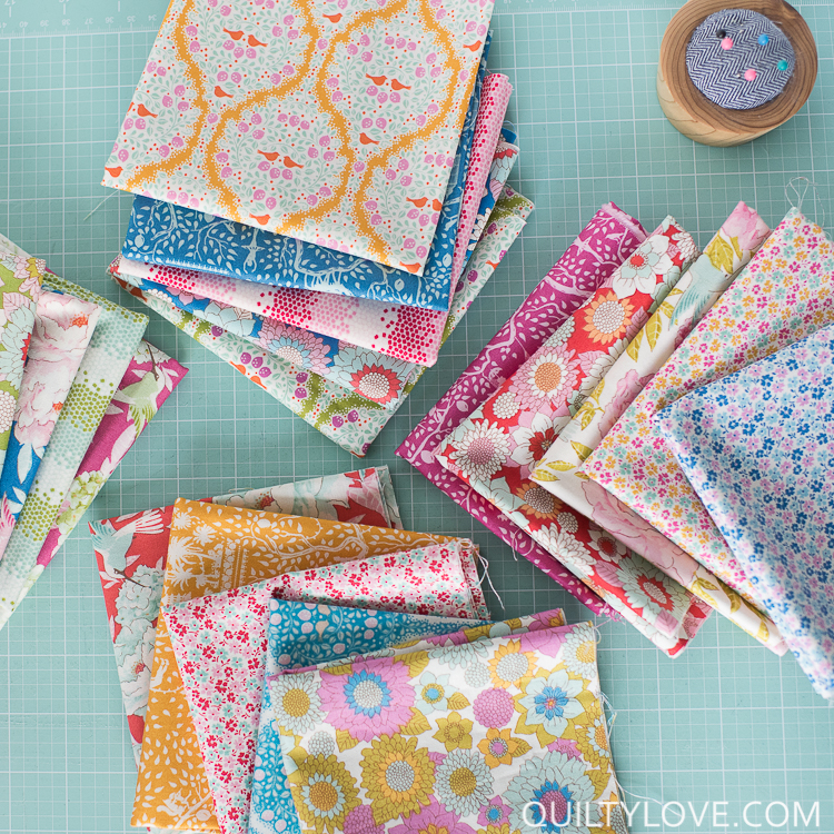 Lemontree fabric fat quarters on aqua cutting mat