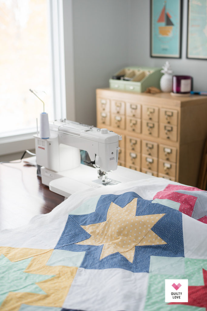 North Star quilt being quilted on a Janome