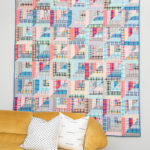 Flannel Lucky Log Cabins quilt with yellow couch